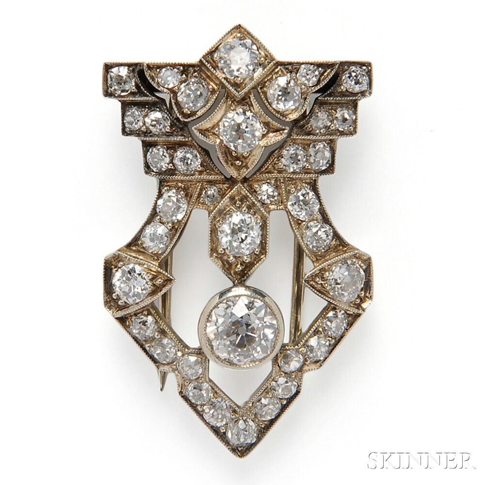 Art Deco 14kt White Gold and Diamond Clip Brooch, set with old European and old mine-cut diamonds, approx. 2.32 cts. 1.25in long. Sold by Skinner for $2,583 Pinned by #Blucha from skinnerinc.com