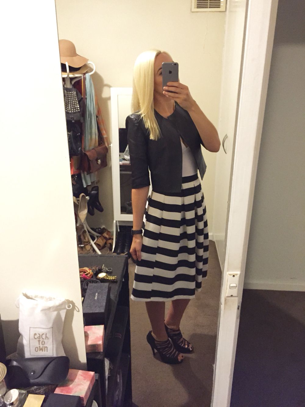 Style: Cropped black leather jacket, white Kookai singlet, black and white stripe skirt and black strappy heels