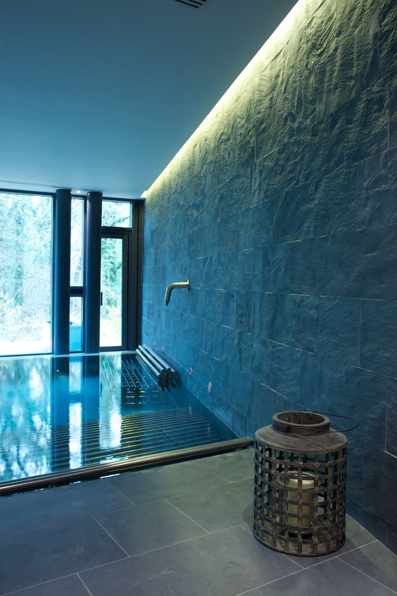 Spa-like swimming pool using bespoke granite with a flame ...