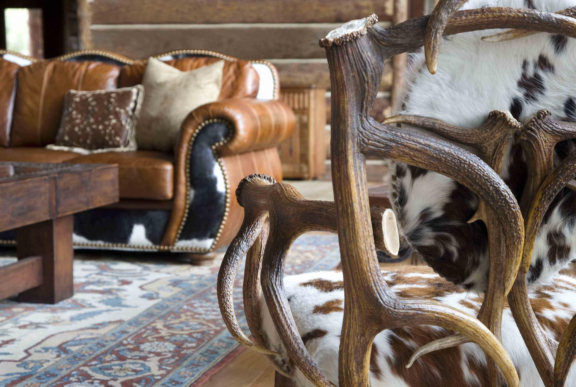 Although I'm not THAT rustic, I love the lines of this #chair in the foreground. Wow... beautiful. I also adore the nailhead trim and the cowhide on the leather #sofa in the background. I just can't get over the fact that these were...animals...at one point. Admiring the beauty...well, after the fact.