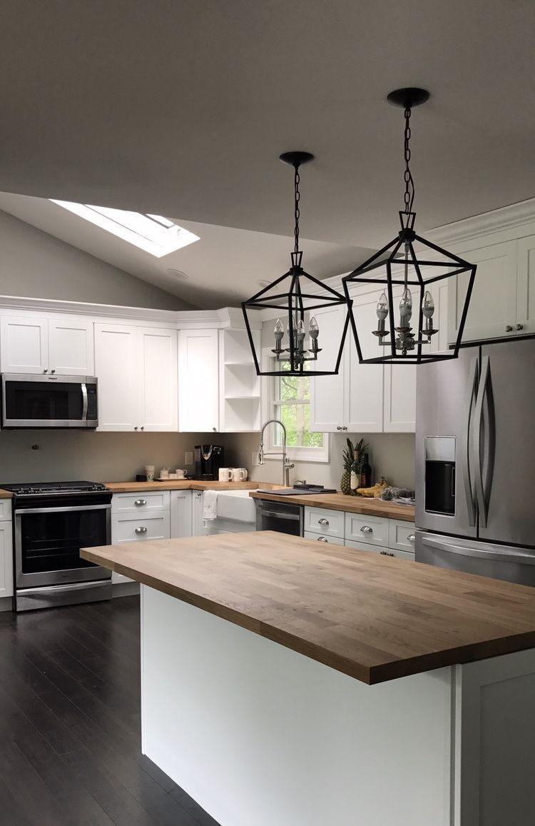 Beautiful kitchen that features butcher block countertops, a ...