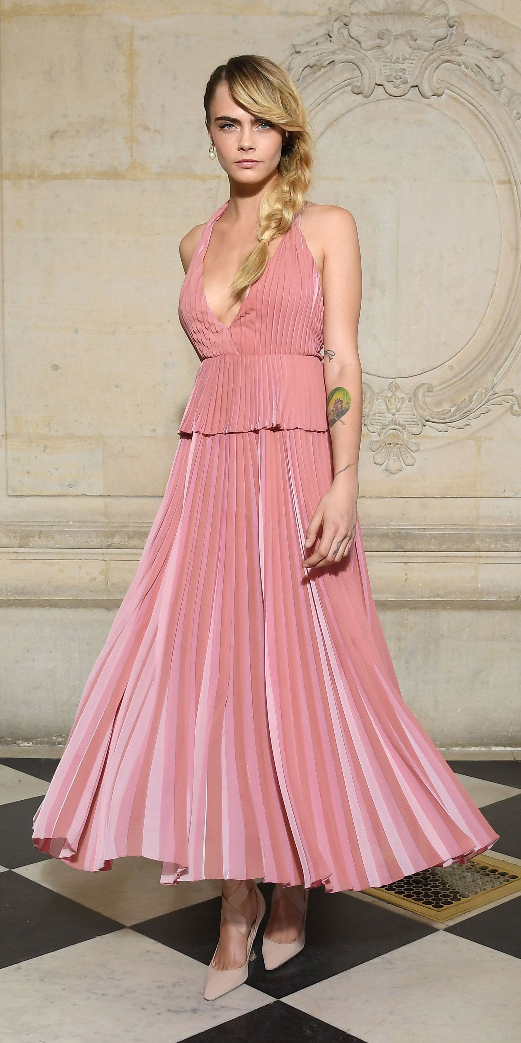 7ebad84bb954 For Dior's Fall 2019 presentation, Cara Delevingne switched up her edgy  style in a girly pink Dior dress and ballerina-inspired pumps.