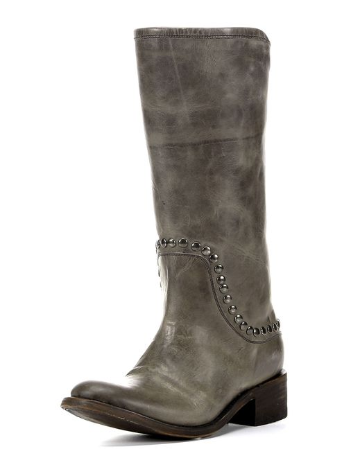 Briley's bold gunmetal studs bring out subtle textures in the distressed leather. The neutral hue leather make this a highly versatile midcalf boot.
