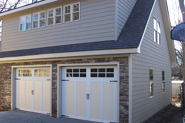 2 car garage with bonus room has 2 shed dormers to make for 2 story house plans with dormers