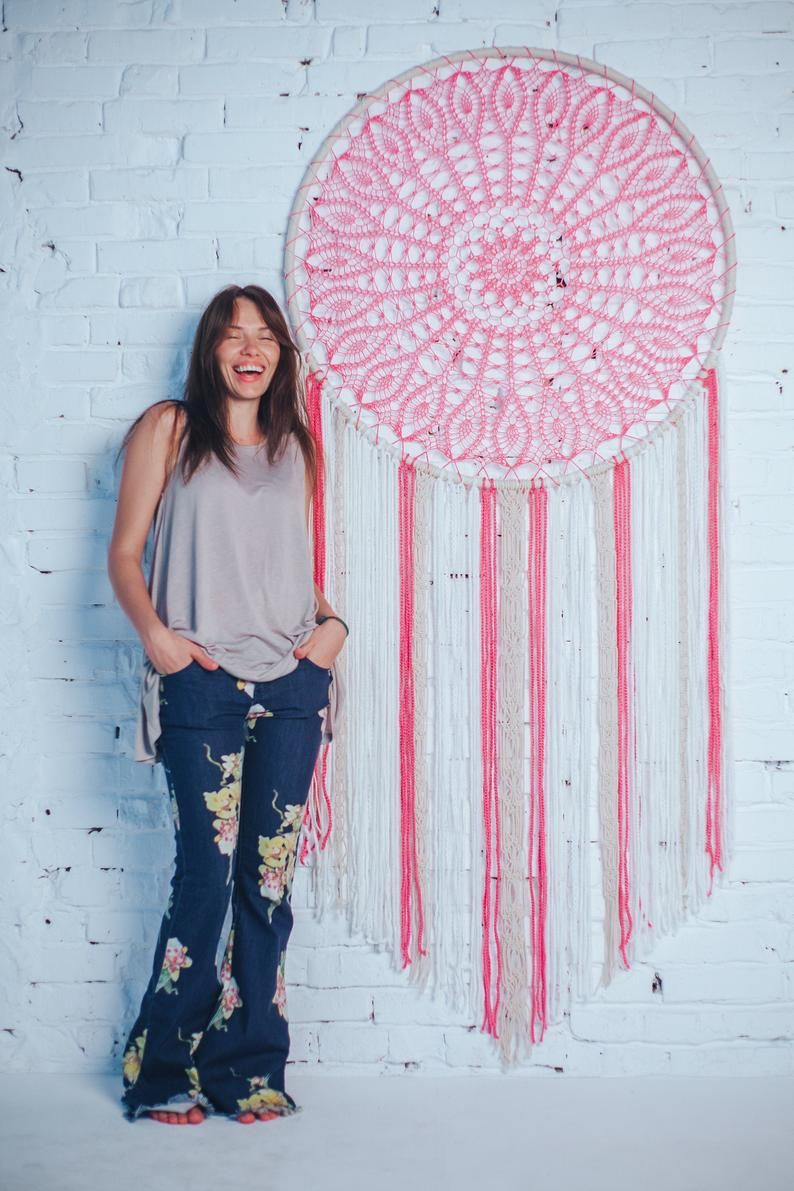 Would this pink extra large dream catcher melt your heart? Absolutely. This is a beautiful handcrafted wall art piece that will bring peace and serenity to your bedroom, nursery or little girls room. Consider this giant dream catcher, if are looking for a gift for a boho lover. Boho wall art for a dream bohemian home. Pure beauty.  #dreamcatcher #dream catcher #bohodecor #bohohome #girlfriendgift #babygift