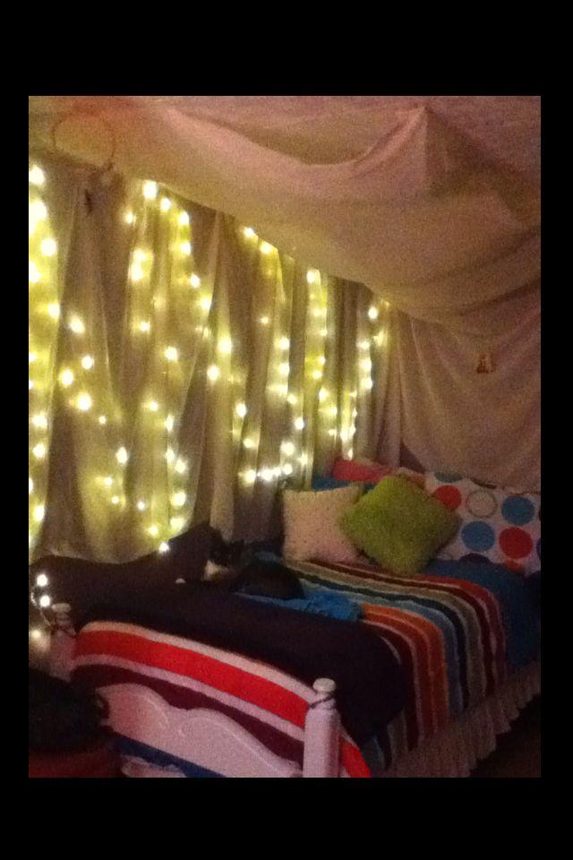 Hang Up Xmas Lights And Drape Fabric Over On The Walls And