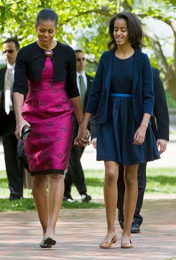 The First Lady's Brooch pins her cropped cardigan gracefully over her Thakoon sheath dress for an elegant Easter Sunday.