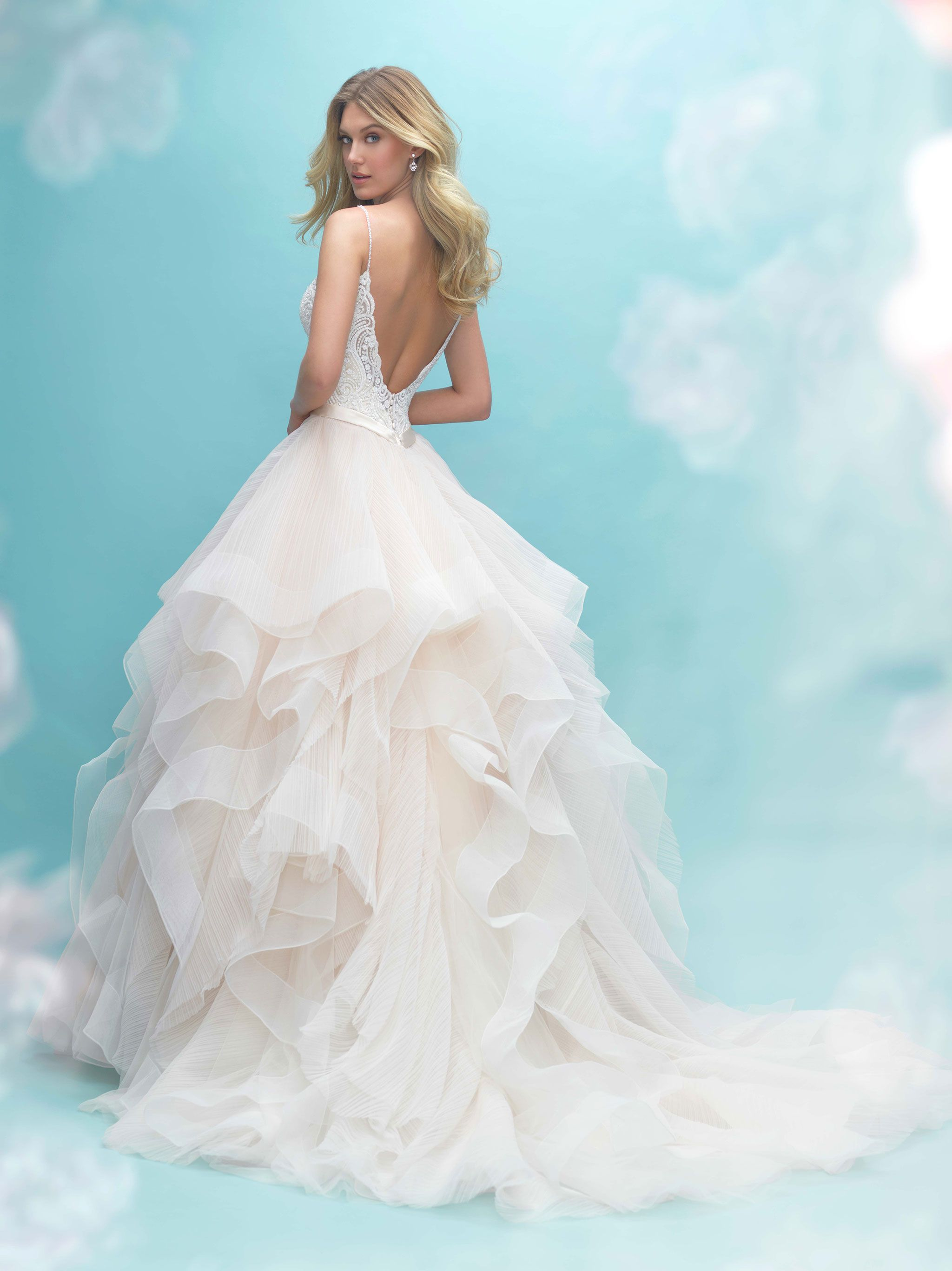 Airy, textured ruffles comprise the skirt of this delicate ballgown ...