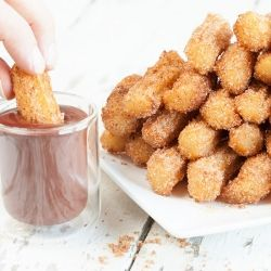 Spanish churros with raspberry chocolate sauce you can make in half an hour. Simply delicious and fun! Easy recipe for churros.