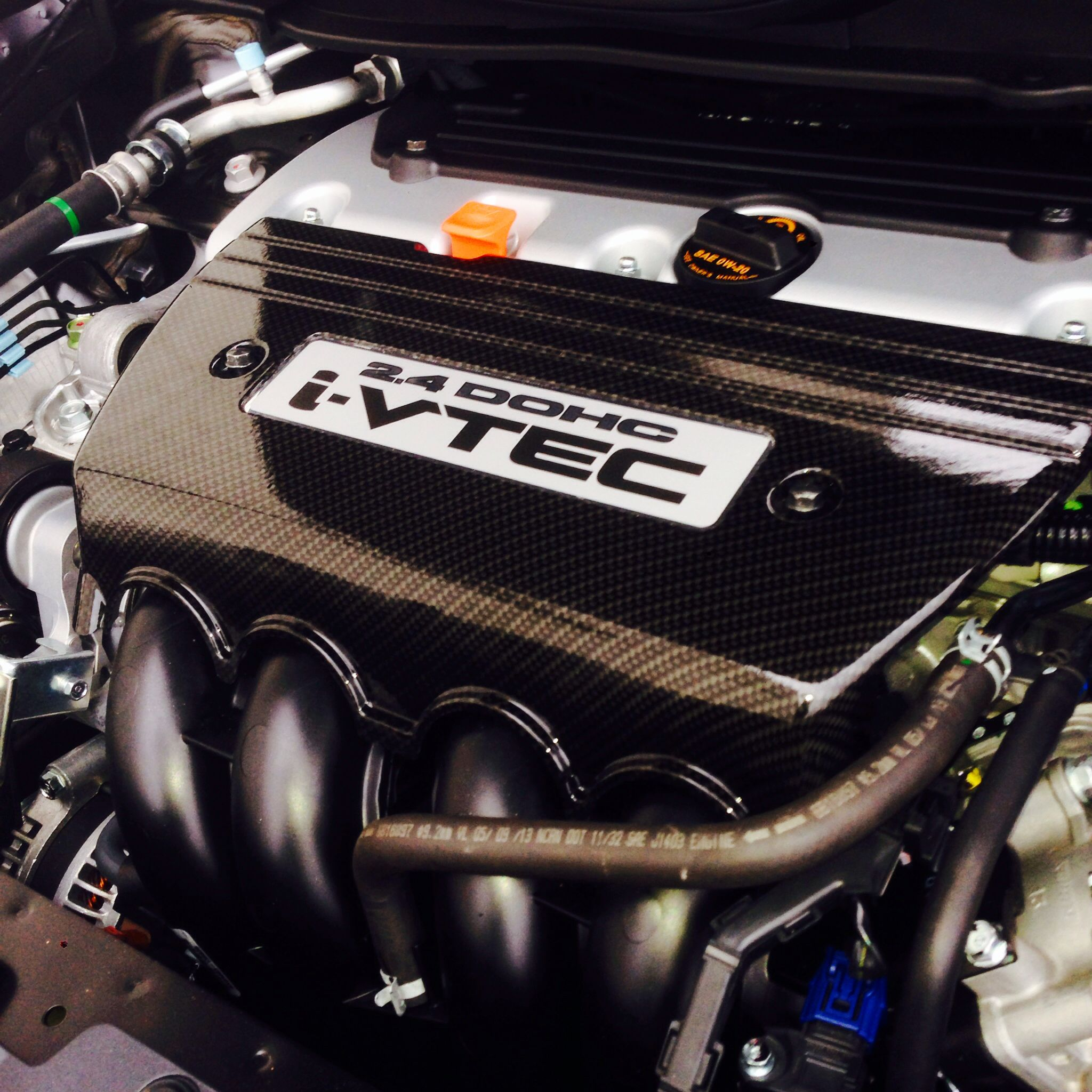 Carbon Fiber hydro dipped intake manifold cover by Voyles