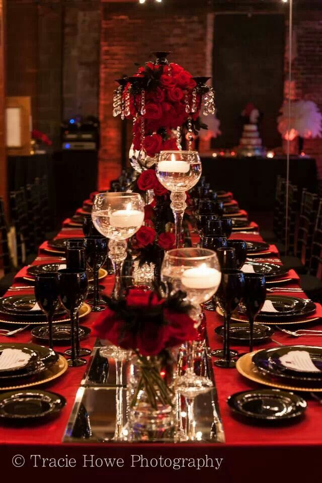 Stunning and elegant black candelabra with red roses and black stunning and elegant black candelabra with red roses and black feathers for a barcelona gatsby themed junglespirit Images