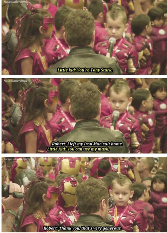 Robert Downey Jr. meeting kids at an Iron Man costume contest at San Diego Comic Con, 2012.