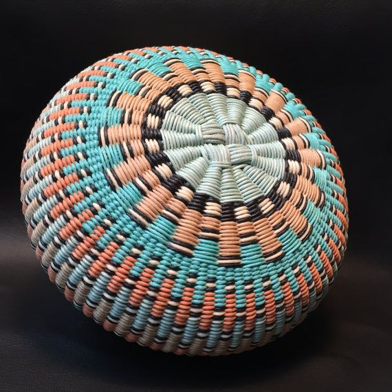 Admiration (2016)  I called this basket Admiration since I got my inspiration for the design from a Hopi wicker plaque.  This basket is made with 1mm light aqua, cream, light tan, light teal green, peach and black waxed cotton cord and has a very appealing geometric design.  ____________________________________________________________________________  Size: Approximately 6 inches across and 2.75 inches tall  ____________________________________________________________________________  Visit…