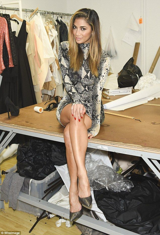 Scherzinger shows off her pert posterior in skintight snakeskin Poser: She crossed over her never ending legs as she perched backstage at the prefall previewPoser: She crossed over her never ending legs as she perched backstage at the prefall preview