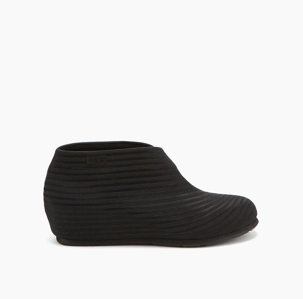 "United Nude's Fold Lo (Black), with hidden 4 cm / 1.6"" wegde heel."