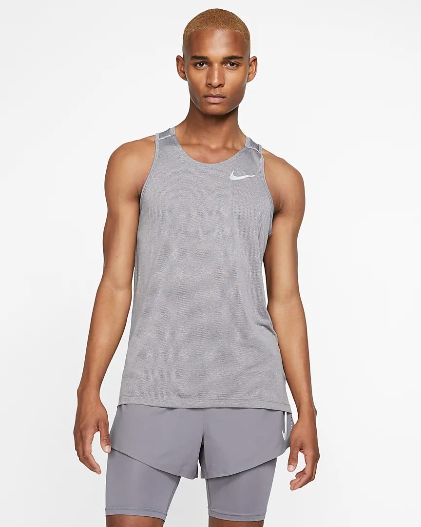 Grabar máscara Hueso  Nike Dri-FIT Miler Men's Running Tank. Nike.com in 2020   Running tanks,  Man running, Athletic tank tops