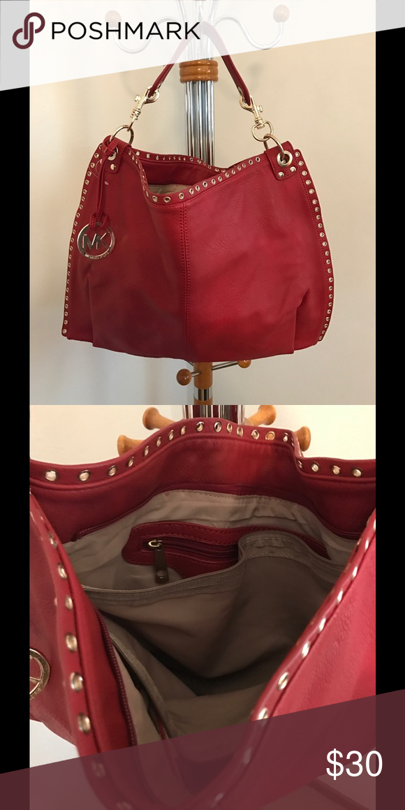 Red 100%. PVC very large bag Very large red bag, great for shopping to throw your small packages in.  Its 100% PVC with gold hardware.  It has a MK fob hanging on it but there is nothing else to suggest its a MK bag.  2 Zipper pockets inside and 2 other pockets inside.  One zipper pocket on the back of the bag. Bags Satchels
