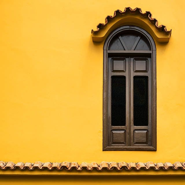 arched window + yellow wall   architectural details