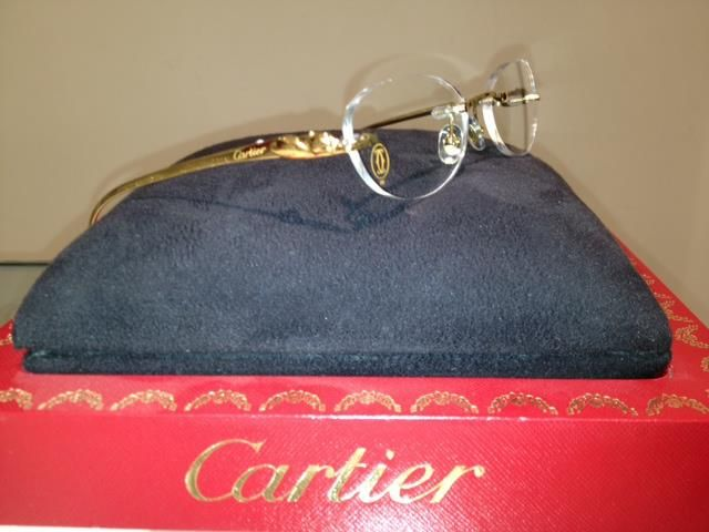 295a7049c2006 Cartier Glasses with Gold Panther Temples.