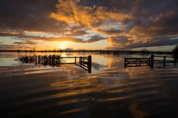 A red sky at night offers hope for the flooded farm land of the Somerset Levels.