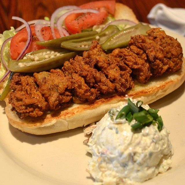 Fried Oyster Po'boy with Lettuce, Tomato, Onion, Pickled Okra and Tobasco Mayo.