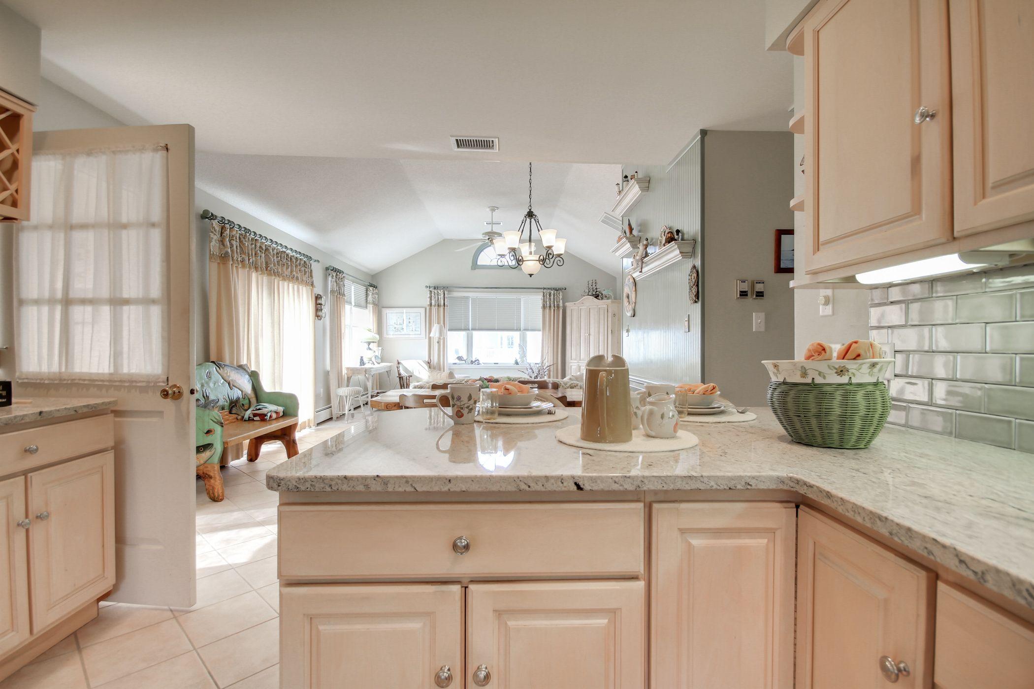 Best Beach House Kitchen With Crema Astoria Granite Countertops 400 x 300