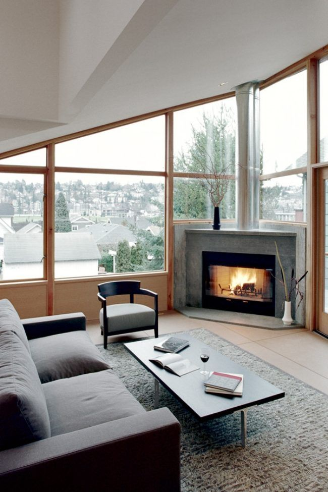eckkamin holz brennstoff dachschräge raumhohe fenster house - kamin in der wand amerikanisch
