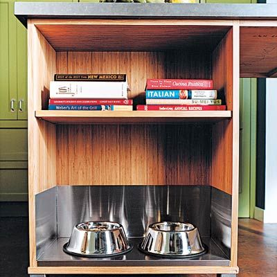Add-Ons: Pet Station  Cater to your dog or cat with a spot for bowls and kibble. Here, food and water dishes rest on a shelf lined with stainless steel. A custom liner from a sheet-metal fabricator will add about 30 percent to the cost of a $1,000 storage island like this one.    Shown: Custom bamboo island; R & J Cabinets