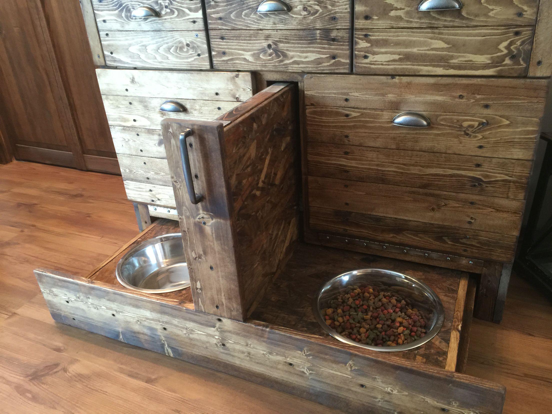 Dog feeding station and dog food storage. Cat food