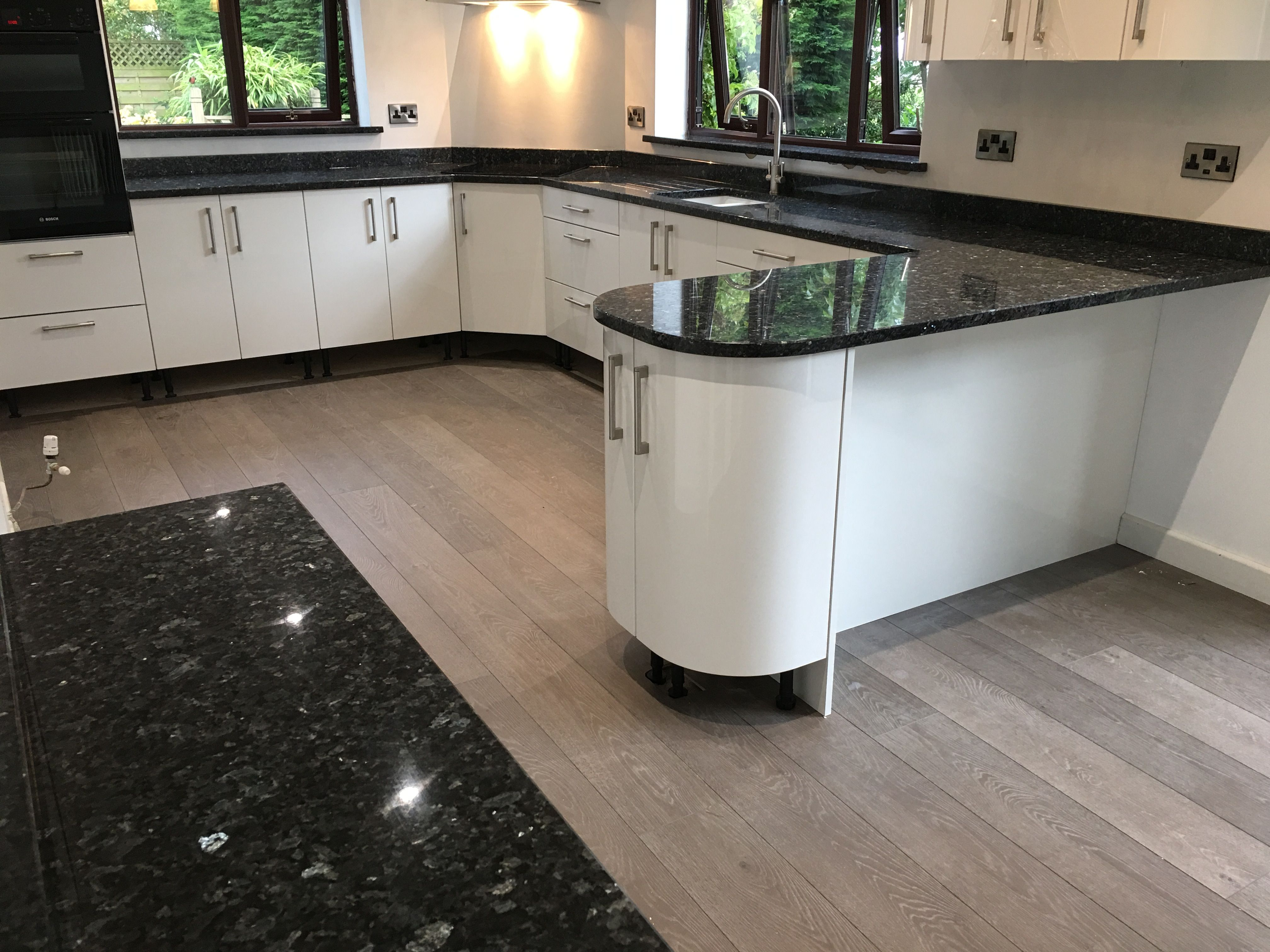 Emerald Pearl Granite Worktops In Buckley On A White Gloss Kitchen