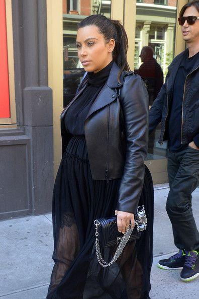 Kim Kardashian Chain Strap Bag - Kim Kardashian took a stroll in NYC sporting a black Chanel Boy bag, leather jacket, and sheer maxi dress combo.