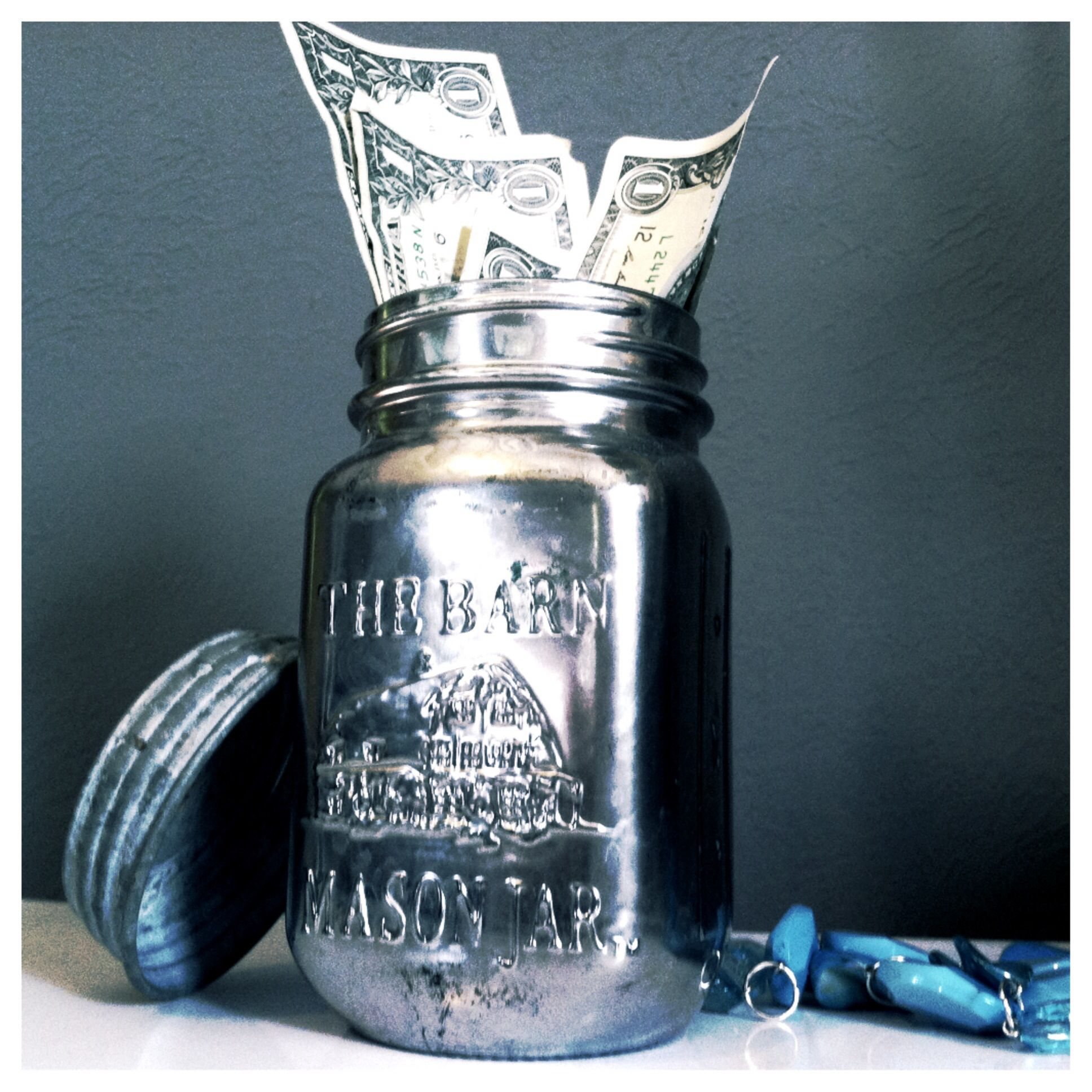 I spray painted an old candle and decided to use it as a piggy bank.  It was super easy and my money is hidden.