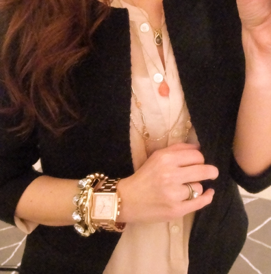 love the mixing of bracelets with a bigger watch.  love the pale pink with the black blazer.  just love this.