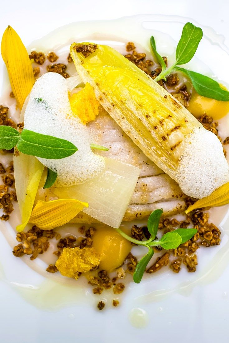 This sous vide fish recipe from Michael Wignall is hard to beat: succulent white fish is paired with creamy velouté, orange curd and sunflower granola.