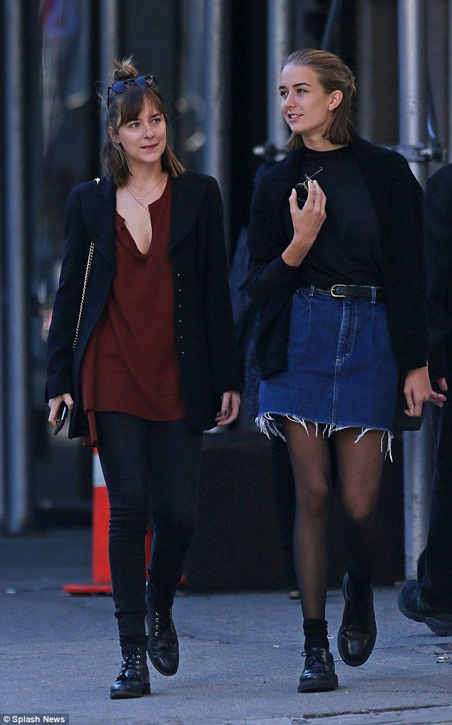 Dakota Johnson looked casual as she hung out with half-sister Grace Johnson, 15, in New York's West Village