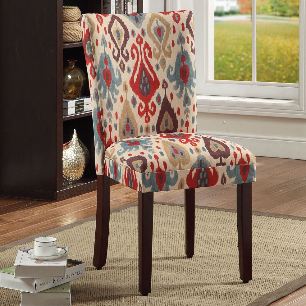 A Beautiful Multi Colored Ikat Pattern Decorates The Fabric Upholstery Of These Parson Dining Chair