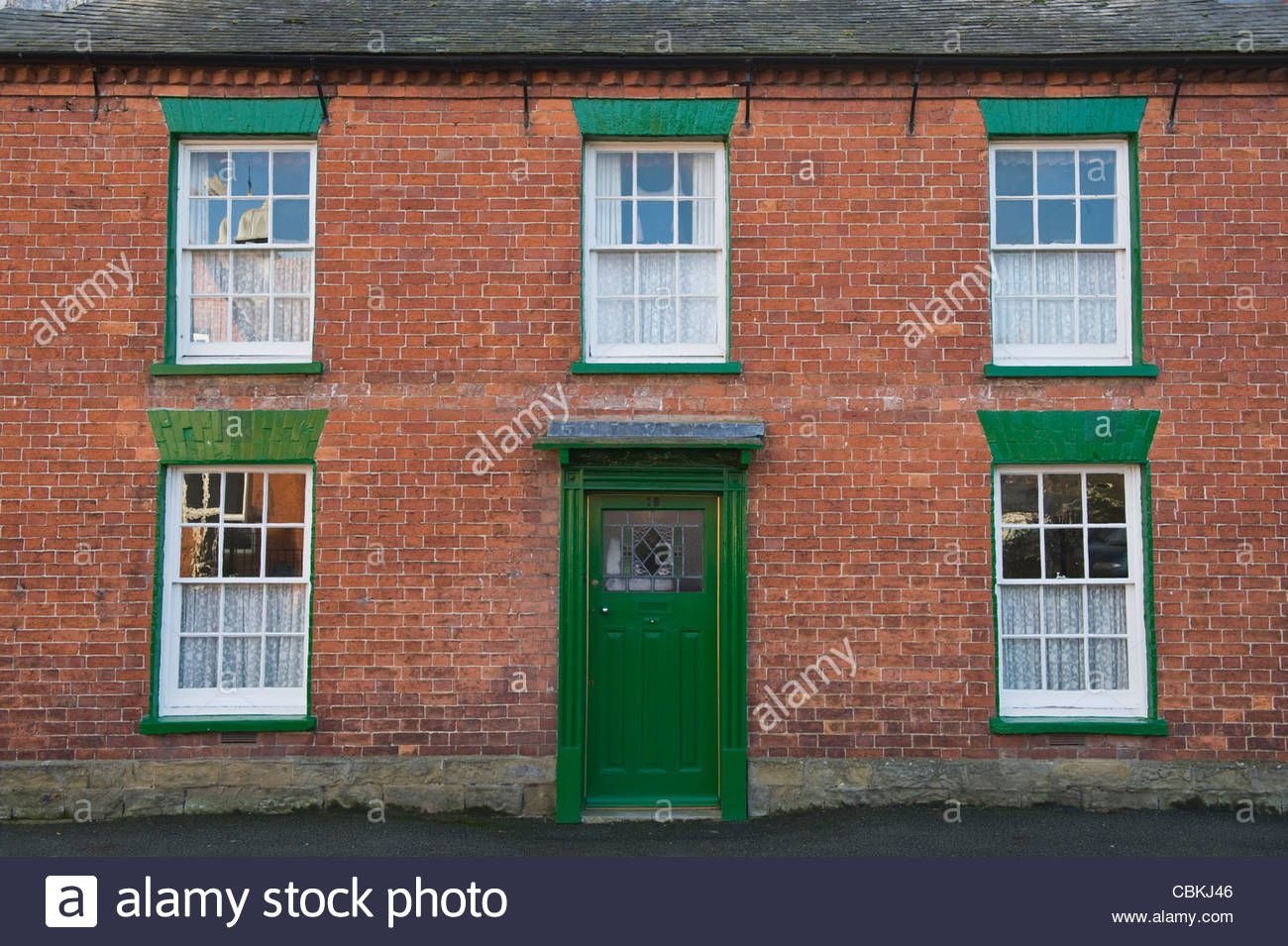 Red front door on brick house - Detached Period Red Brick House With Sash Windows And Green Painted Front Door In Kington Herefordshire