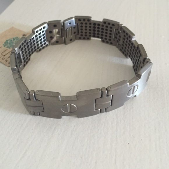 "Super cool Titanium men's bracelet BNWT! Super cool Titanium men's bracelet BNWT! Part of our men's collection. This is. Very cool titanium bracelet 8.5"" long and 3/4"" thick. Titanium does not tarnish and it's hypoallergenic. BNWT! These retail over $400 at jewelry stores. I have 3 available Jewelry Bracelets"