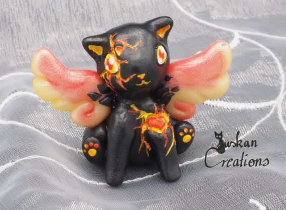 Crackled surface magma cat figure polymerclay von JuskanCreations