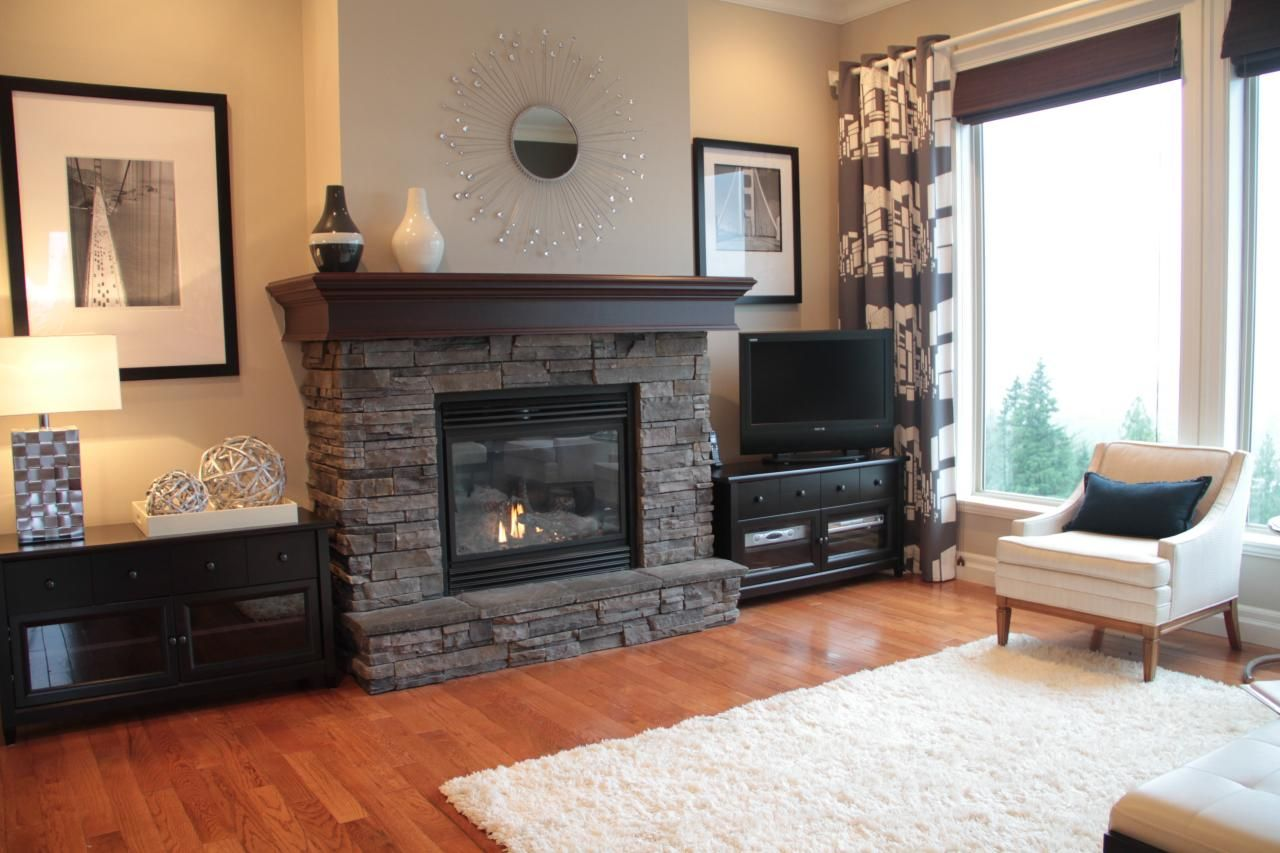 Gray stacked ledgestone and a rich mahogany wood mantel for Grey stone fireplace surrounds