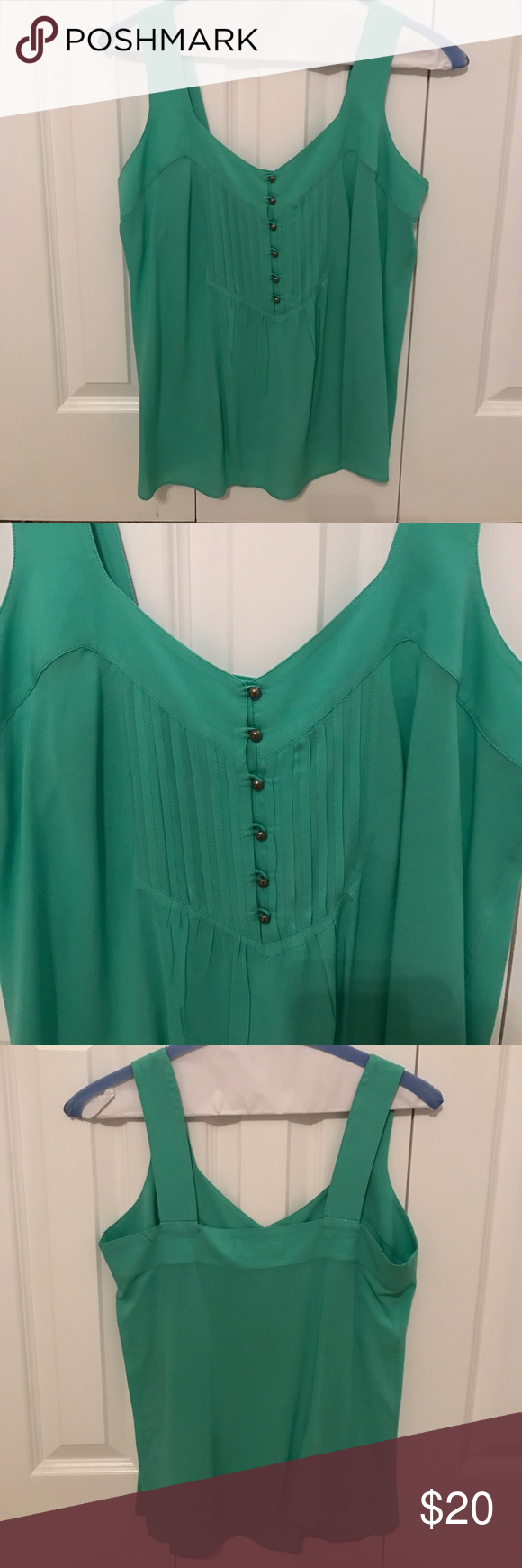 Banana republic top! Banana republic tank top. Size 8, barely worn. Front button detail, flows.  Mint color. Good summer top! Banana Republic Tops