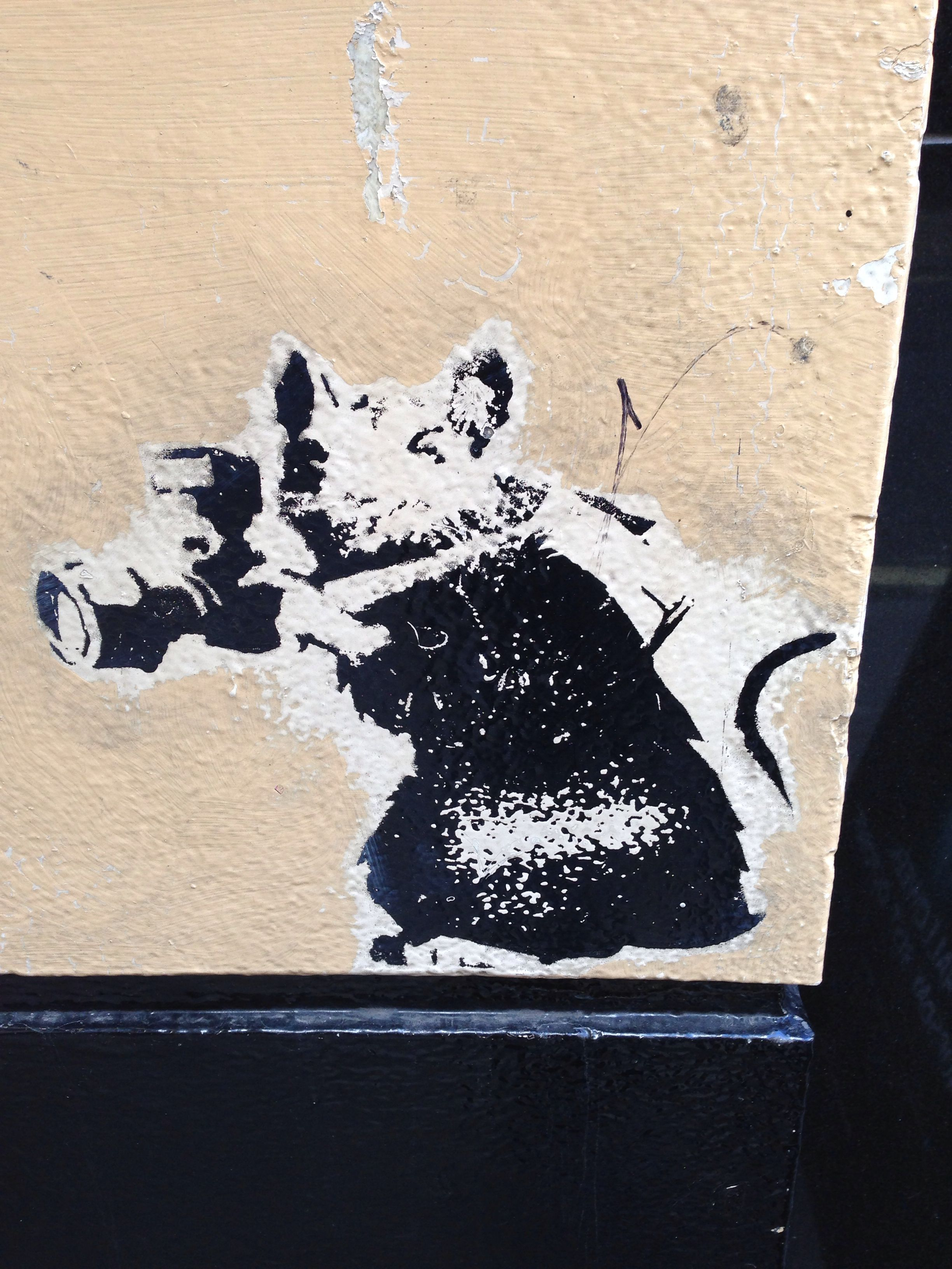 Banksy graffiti / stencil / piece at downtown London. Spotted below a restaurant window.