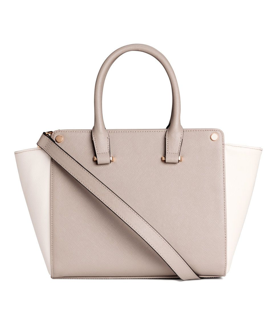 41c43d8cd Small handbag in grained faux leather with two handles, a zip at top, and a  narrow, detachable shoulder strap. One inner compartment with zip. Lined.