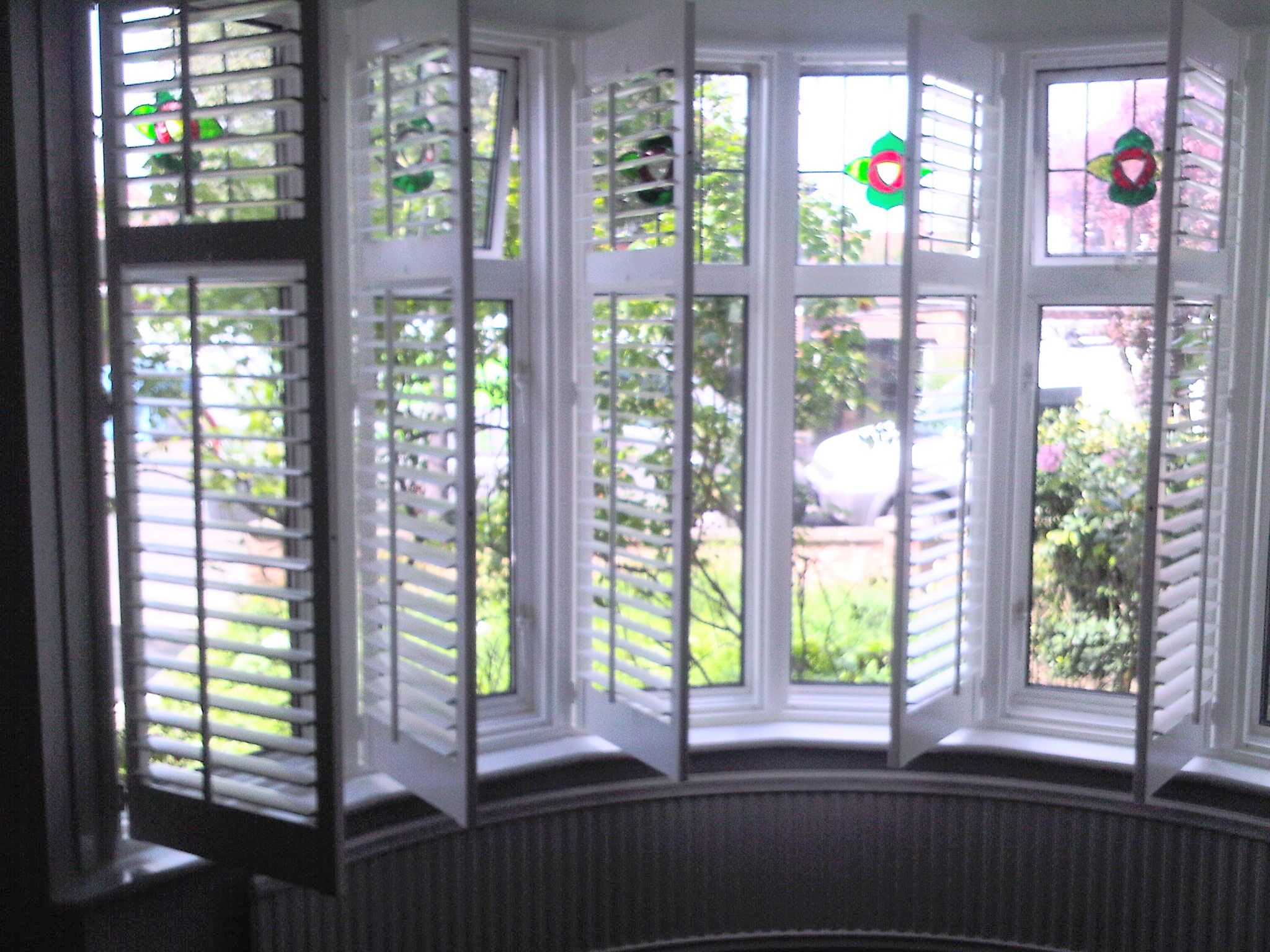 Bay window interior wooden window shutters from long for Bay window interior