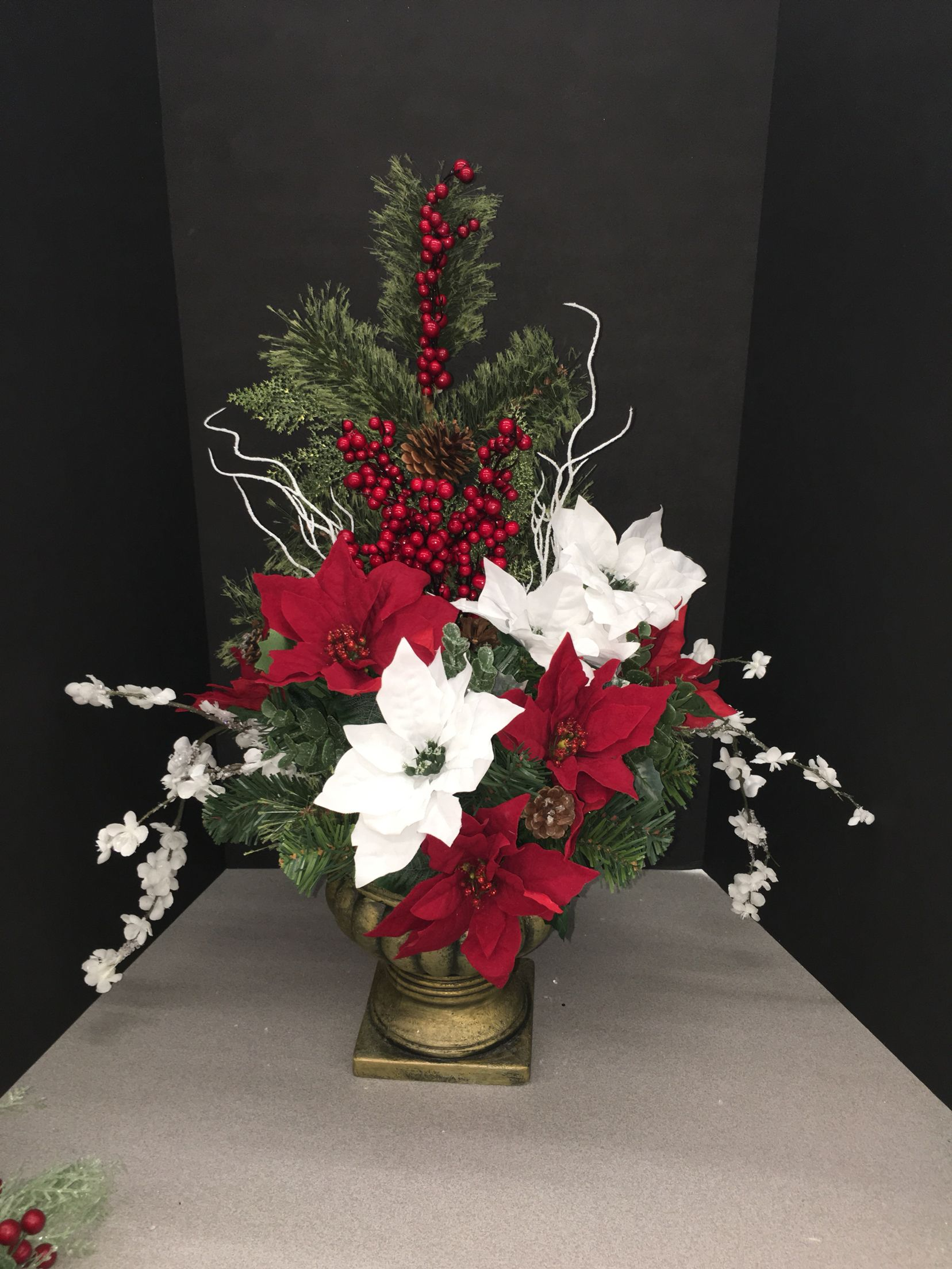 Red berries red and white poinsettias Christmas flower