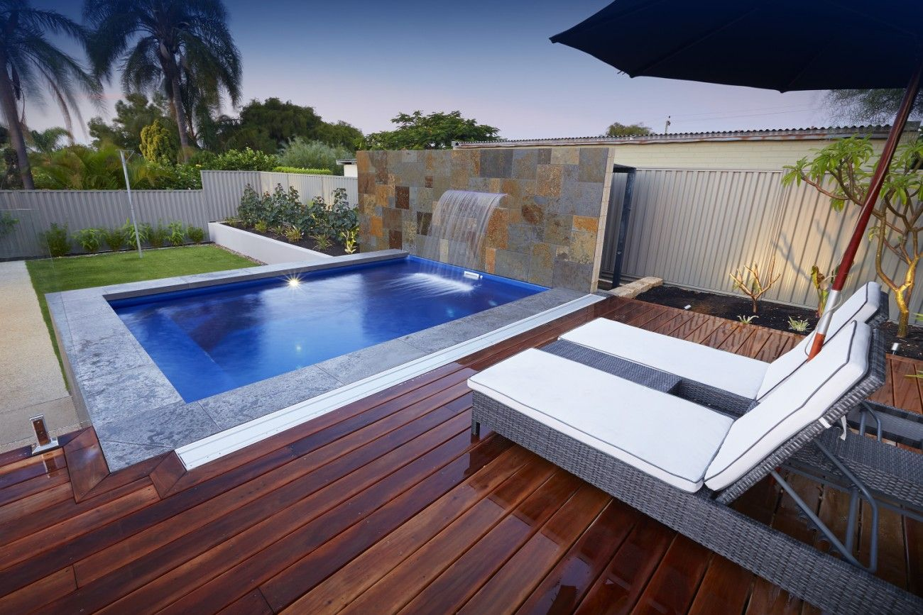One of our 4.7m Ultimate Plunge Pools with a water feature