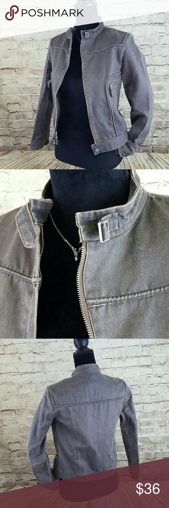 MAX JEANS Motor Jacket Cute! This fabric moto jacket has the look of distressed leather even down to the corded, rolled seams. Brownish grey cast to it. Full zip with logo button at the bottom. Strap and buckle closure at neck. Two zippered pockets with fobs. Awesome little jacket in very nice used condition. 55% cotton/45% polyester. Dry clean. I ship fast. Max Jeans Jackets & Coats