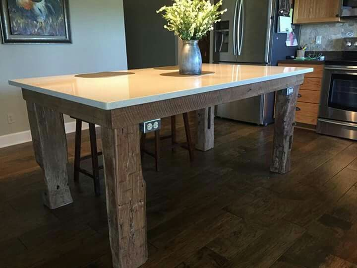 Counter Height Table With Walnut Legs And A Granite Top