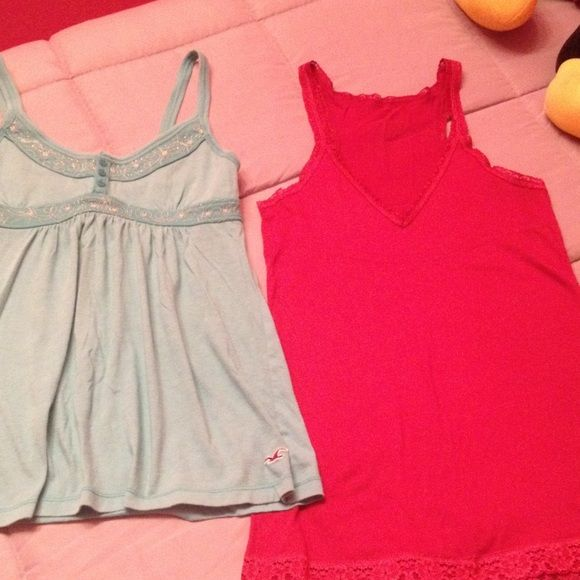 Hollister tops bundle Two small Hollister tops. One light blue and the other red. One red racer back tank top. The other one is light blue with a gorgeous silver thread around the top. Hollister Tops