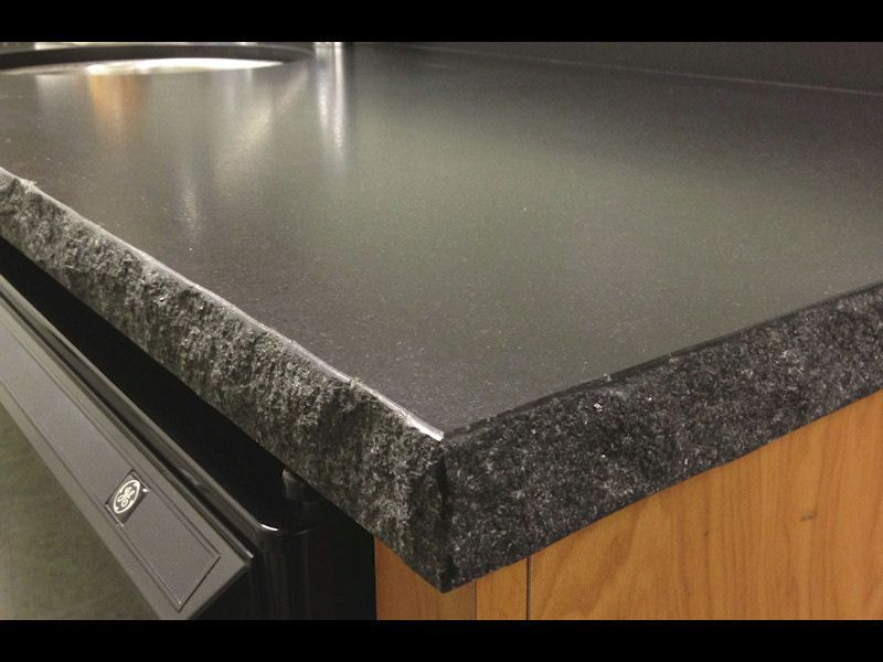Negresco Honed Leathered Granite For Perimeter Kitchen Kitchen Negresco Honed Granite Waterfall Countertop Shaker Cabinets